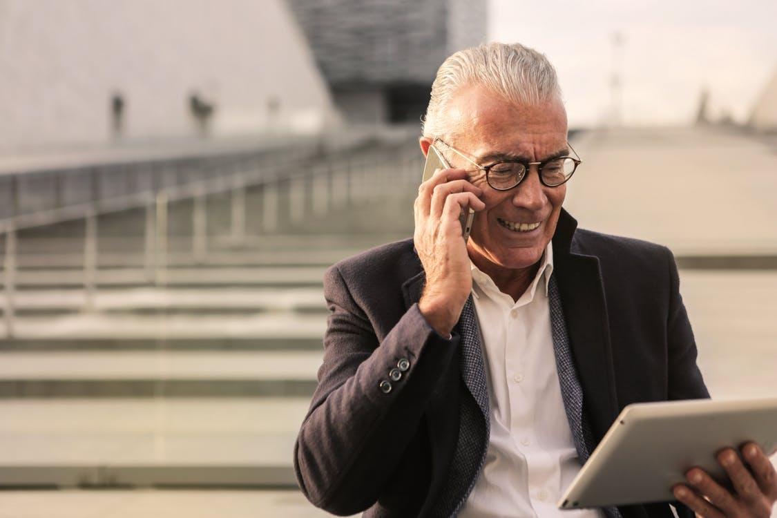 Man In Black Suit Wearing Eyeglasses