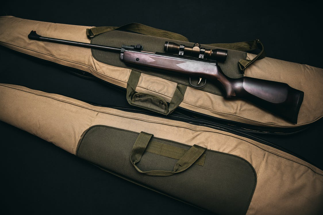Black Rifle With Scope and Brown Gig Bag